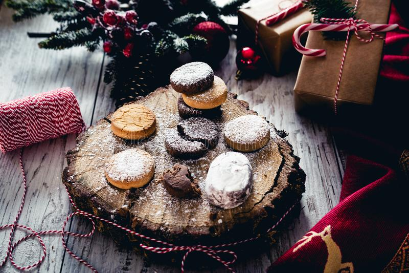 Traditional Spanish Christmas candy. Andalusian Shortbread cookies Polvorones on oak tree trunk stock images