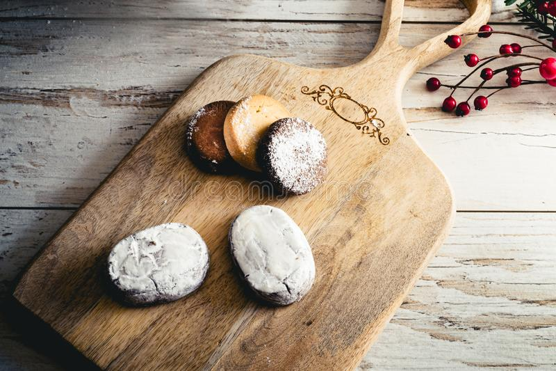 Traditional Spanish Christmas candy. Traditional Spanish Christmas candy. Andalusian Shortbread cookies Polvorones on wooden bac stock photo