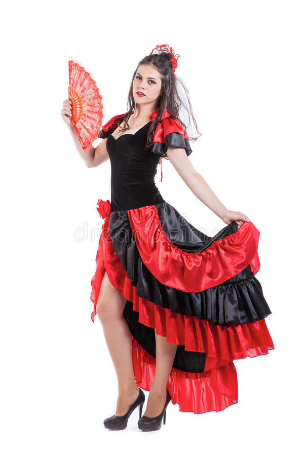 Traditional Spanish Flamenco woman dancer in a red. Spanish Flamenco dancer dancing in a red dress with a fan royalty free stock photo