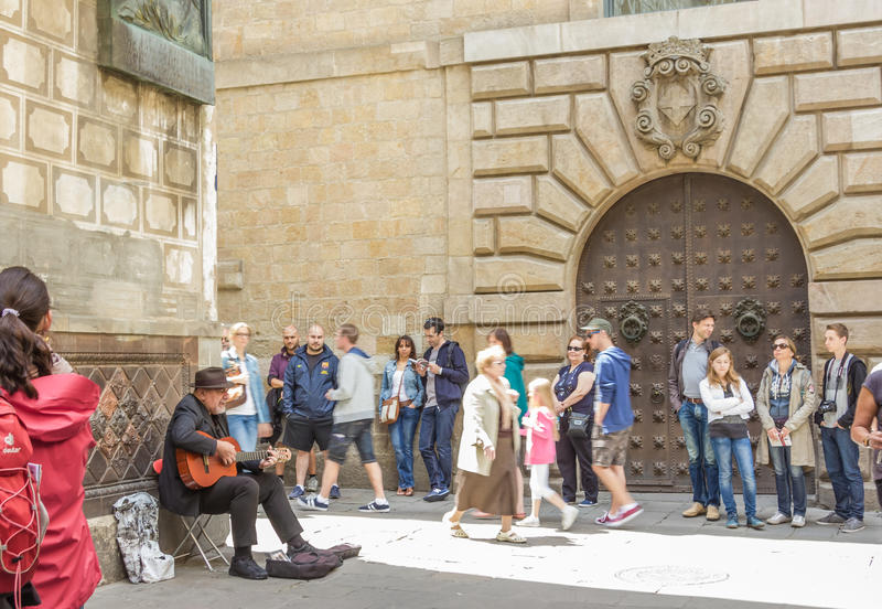 Traditional spanish guitar player in the gothic quarter of Barcelona, Spain royalty free stock photo