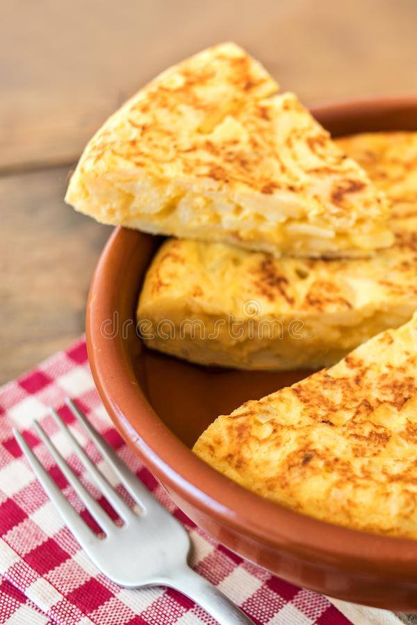 Traditional spanish omelette close up, view from above. Spanish royalty free stock image