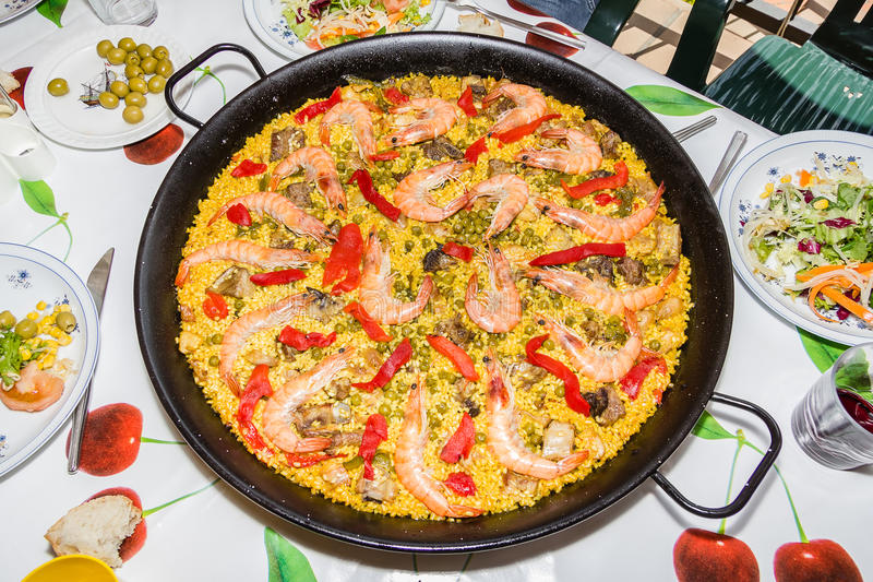 Traditional spanish paella cooked in a pan stock images