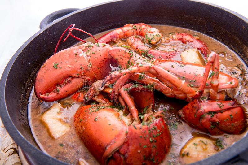 Traditional spanish paella rice with lobster and meat on pan royalty free stock photo