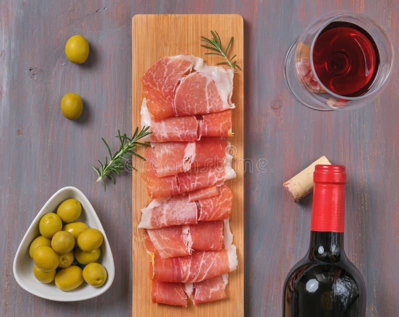 Traditional spanish tapas, snacks slices of serrano ham stock images
