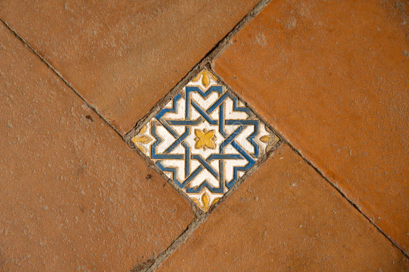 Traditional Spanish tiles. Colorful floor tiles of the Monastery of Saint John of the Kings, Toledo royalty free stock image