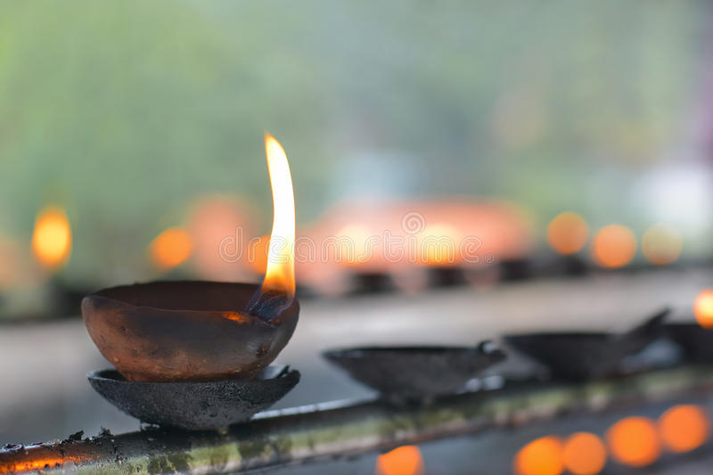 Traditional Sri Lankan Clay Oil Lamps. Traditional Clay Oil Lamps Lit At The Buddhist Temple In Sri Lanka. Clay Lamps Lit At Local Festivals As Light Is stock image