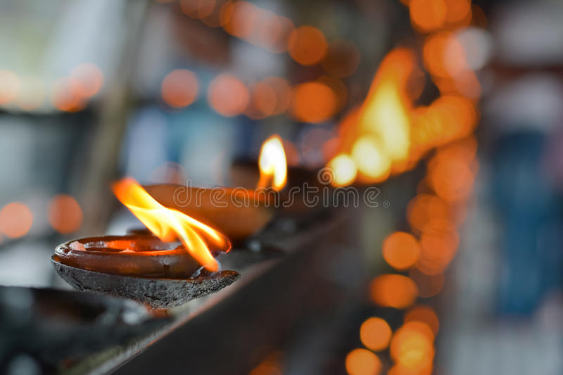 Traditional Sri Lankan Clay Oil Lamps. Traditional Clay Oil Lamps Lit At The Buddhist Temple In Sri Lanka. Clay Lamps Lit At Local Festivals As Light Is stock photography