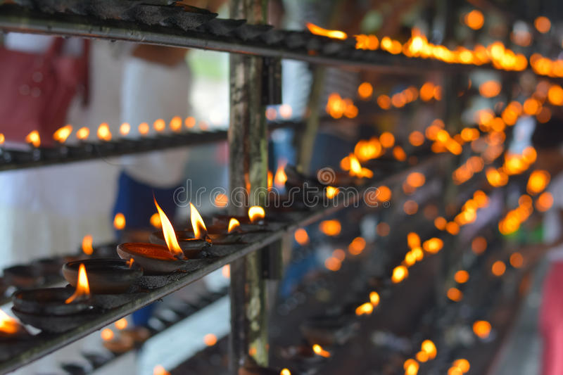 Traditional Sri Lankan Clay Oil Lamps. Traditional Clay Oil Lamps Lit At The Buddhist Temple In Sri Lanka. Clay Lamps Lit At Local Festivals As Light Is royalty free stock photography