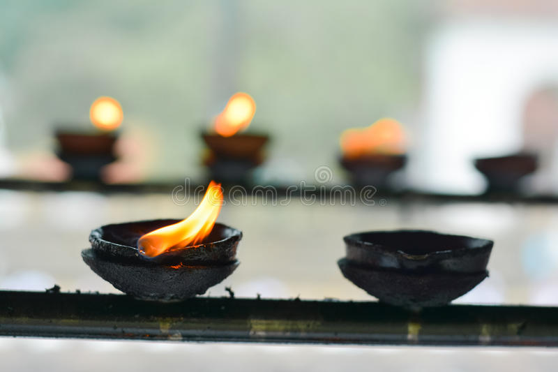Traditional Sri Lankan Clay Oil Lamps. Traditional Clay Oil Lamps Lit At The Buddhist Temple In Sri Lanka. Clay Lamps Lit At Local Festivals As Light Is royalty free stock images