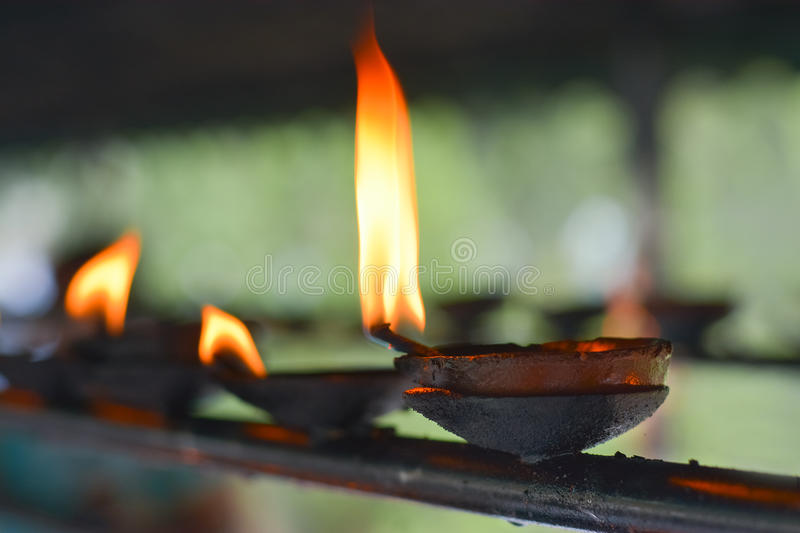 Traditional Sri Lankan Clay Oil Lamps. Traditional Clay Oil Lamps Lit At The Buddhist Temple In Sri Lanka. Clay Lamps Lit At Local Festivals As Light Is royalty free stock photos