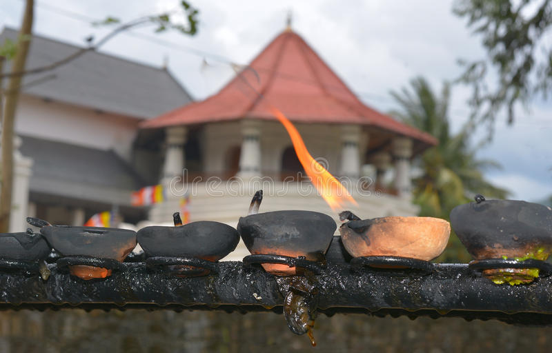 Traditional Sri Lankan Clay Oil Lamps. Traditional Clay Oil Lamps Lit At The Buddhist Temple In Sri Lanka. Clay Lamps Lit At Local Festivals As Light Is royalty free stock photo