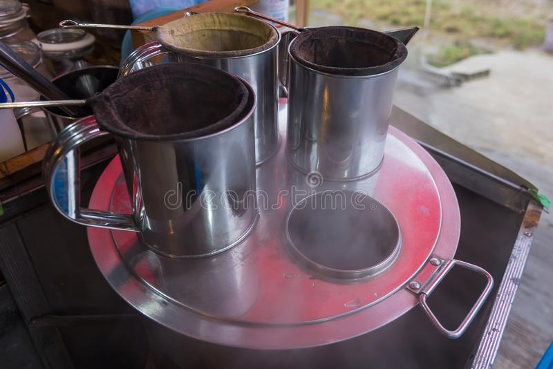 Traditional stainless jug for preparing hot and iced coffee stock images