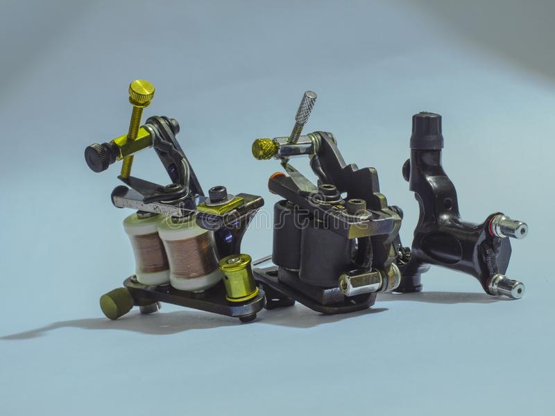 Traditional steel tattoo machine, 3 stock photos
