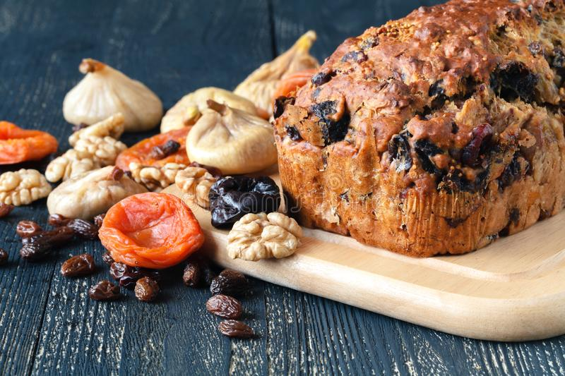 Traditional stollen fruit cake sliced on table royalty free stock photography