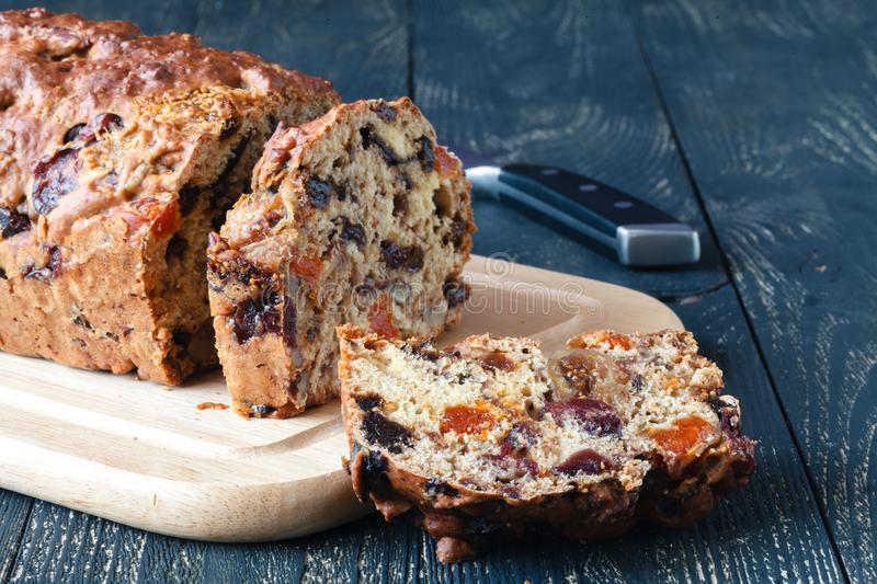 Traditional stollen fruit cake sliced on table stock photography