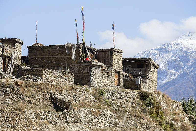 Traditional stone build village of Manang. Mountains in the background. Annapurna area, Himalaya, Nepal royalty free stock image