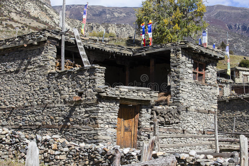 Traditional stone build village of Manang. Mountains in the background. Annapurna area, Himalaya, Nepal royalty free stock photography