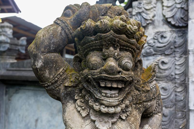 Traditional stone statues depicting demons, gods and Balinese mythological deities in Bali,Indonesia.  stock image