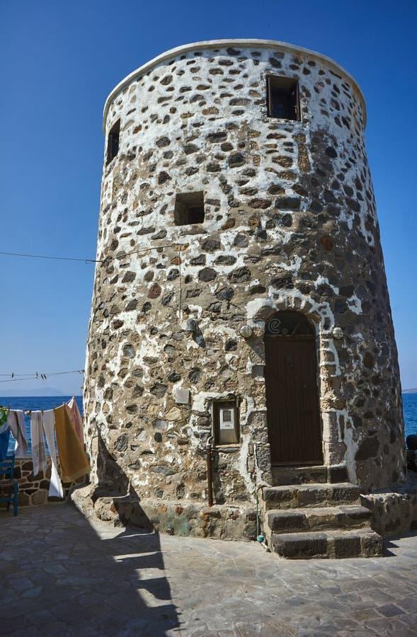 Traditional stone, windmill on the sea shore stock photo