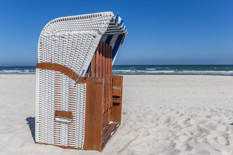 Traditional Strandkorb beach chair on Rugen island. Germany royalty free stock photos