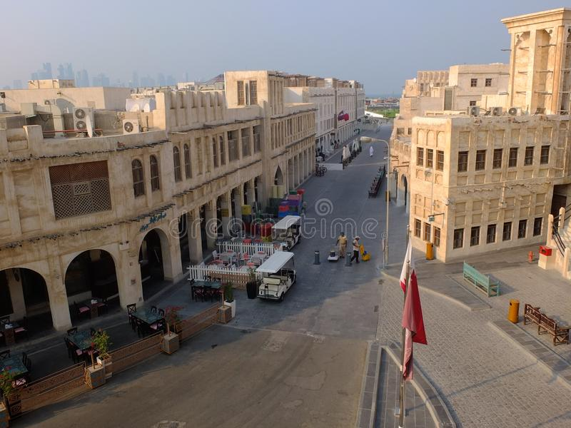 Traditional street and buildings in Doha Qatar. Souq street in Souq Waqif neighborhood, restored historical area with perfect examples of authentic residential royalty free stock photography
