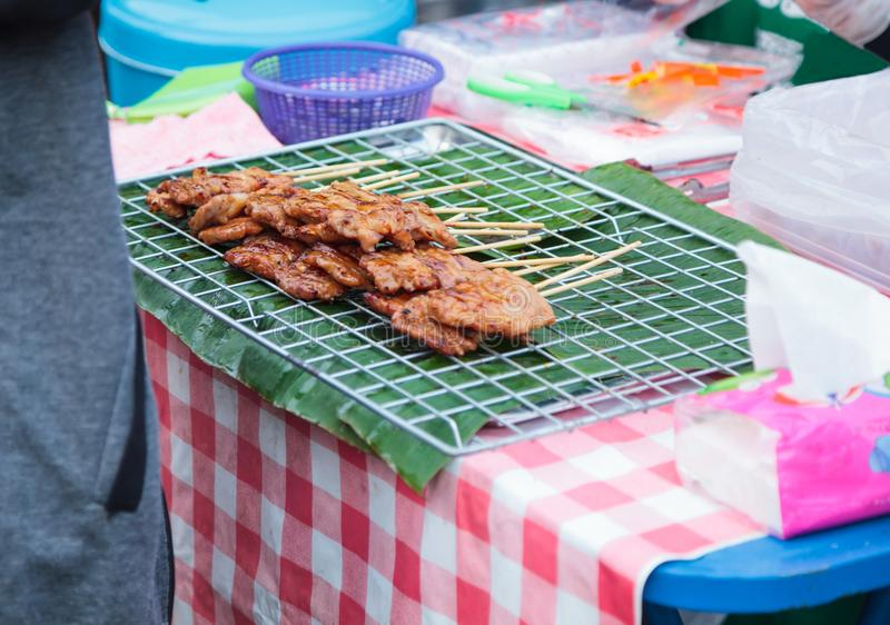Traditional Street Food Cuisine, Thai Marinated Pork Skewers Moo Ping, Barbecue Pork Skewers, Grilled with bamboo sticks and oft stock image