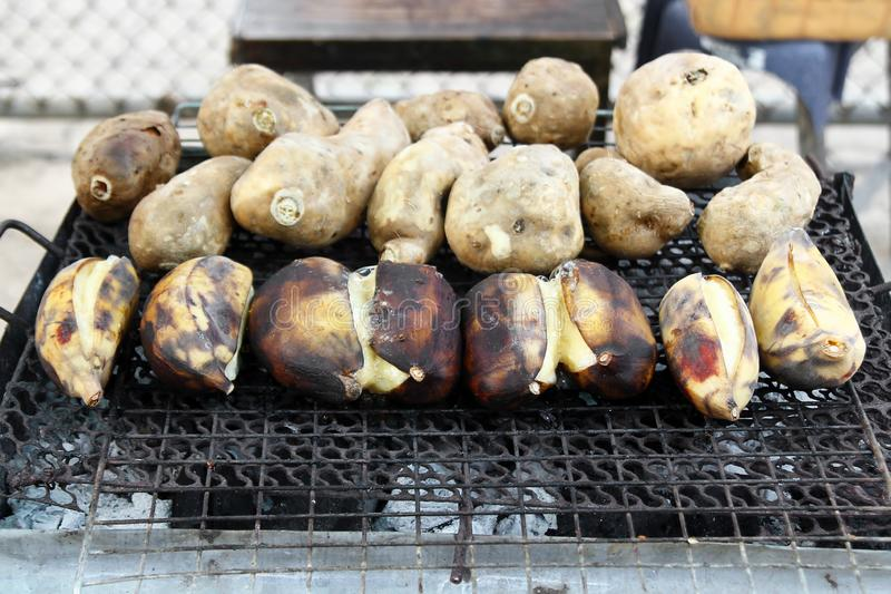 Traditional street food of Thailand - grilled bananas and sweet potato. Chiang Mai, Thailand stock photo