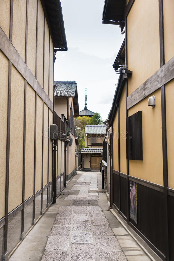 Traditional Street in Kyoto, Japan with distant temple spire. Vertical format royalty free stock images