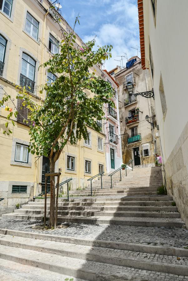Traditional street with staircase in Alfama district stock images