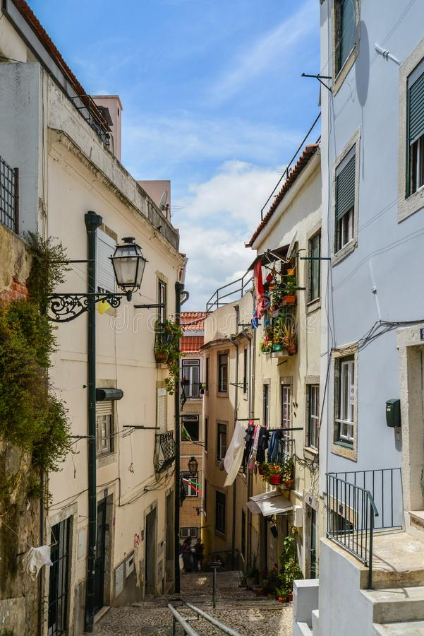 Traditional street with staircase in Alfama royalty free stock image