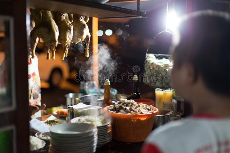 Traditional Street Vendor in Java. A traditional street vendor cart in Jogjakarta, Central Java, selling Javanese fried noodle and rice at night time royalty free stock photos