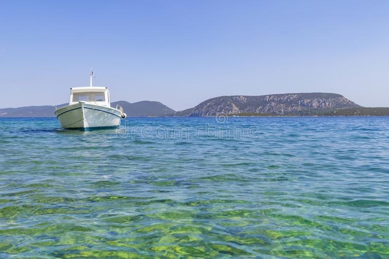 Traditional style boat afloat and moored in blue Mediterranean off Peloponnese coast. Small traditional style boat afloat and moored in blue Mediterranean off royalty free stock images