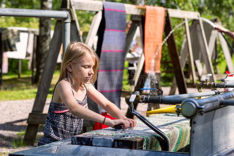 Traditional summer rug washing in Finland stock images