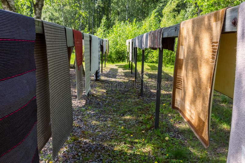 Traditional summer rug washing in Finland stock photos