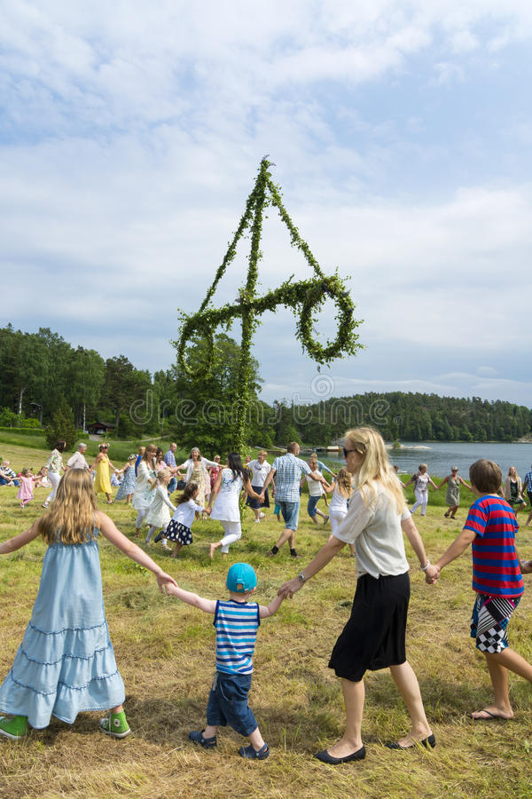 Traditional swedish Midsummer dance. Traditional swedish dancing at Midsummer on June 21, 2013, around a midsummer tree to celebrate the summer. Stockholm stock images
