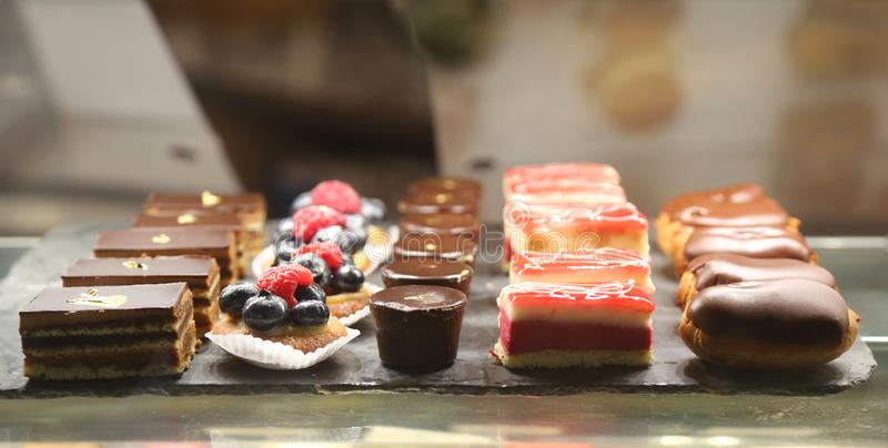 Traditional sweets in French bakery stock image