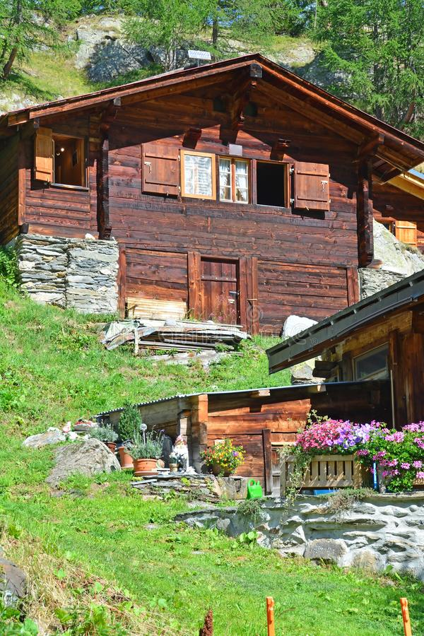 Traditional Swiss Mountain Chalets. In a mountain summer hamlet stock photo