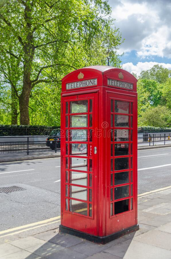 Traditional telephone booth in London United Kingdom UK. Traditional red telephone booth in London in United Kingdom UK stock photos