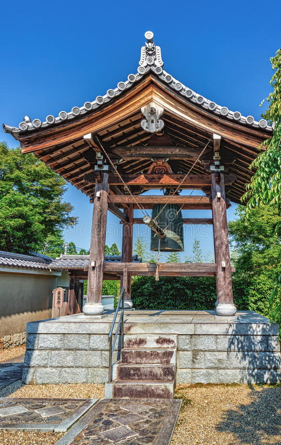 Traditional temple bell in Kinkakuji Temple of the Golden Pavilion in Kyoto, Japan stock image