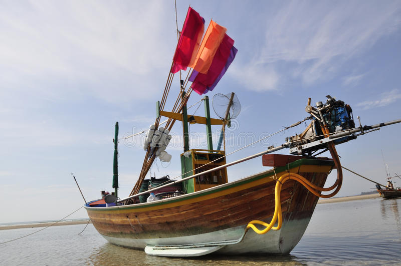 Traditional Thai fishing boat with flags stock images