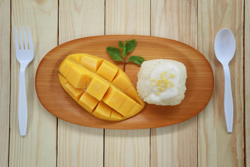 Traditional Thai dessert of mango with sticky rice mix coconut m stock photos