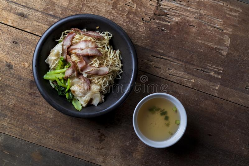 Traditional Thai egg noodles on wooden table top royalty free stock photo