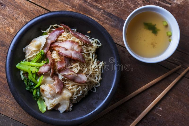Traditional Thai egg noodles on wooden table top stock photography