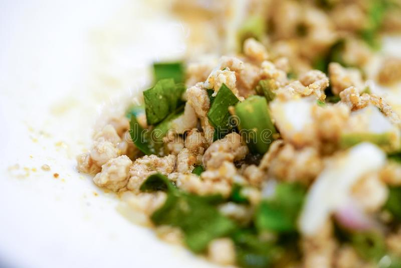 Traditional Thai food, with ground pork lime, chili and herbs. royalty free stock photo
