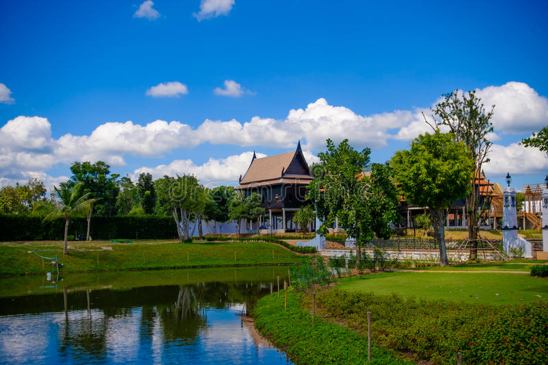 Traditional Thai house style with blue sky in thailand. royalty free stock photos