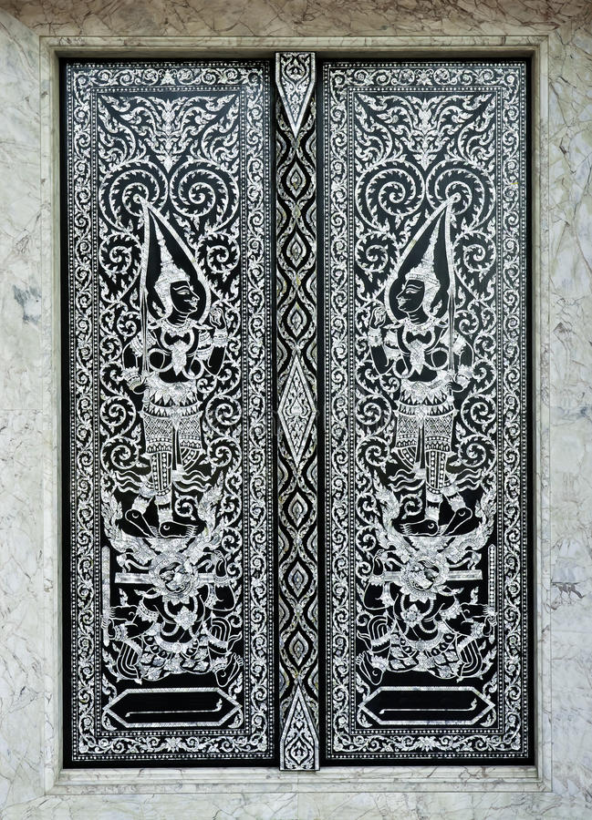 Traditional Thai style church door. Patterned marquetry doors of traditional thai style church door ,General in Thai no potential trademark or copyright stock image