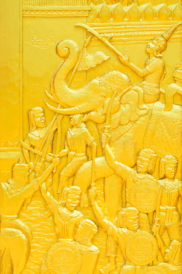 Traditional Thai style golden wood carving about ancient war on royalty free stock photo