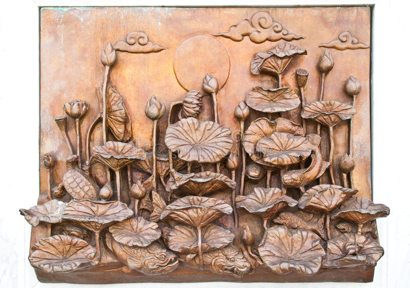 Traditional Thai style old iron statue plate stock image