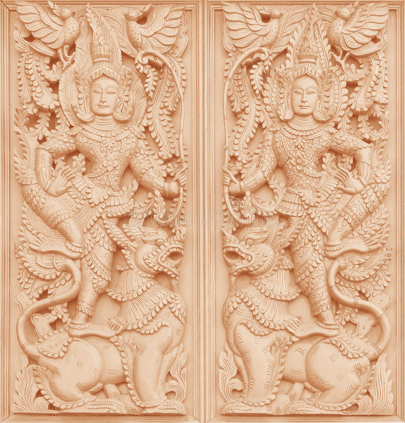 Traditional Thai style wood carving on the wall of Temple royalty free stock photos