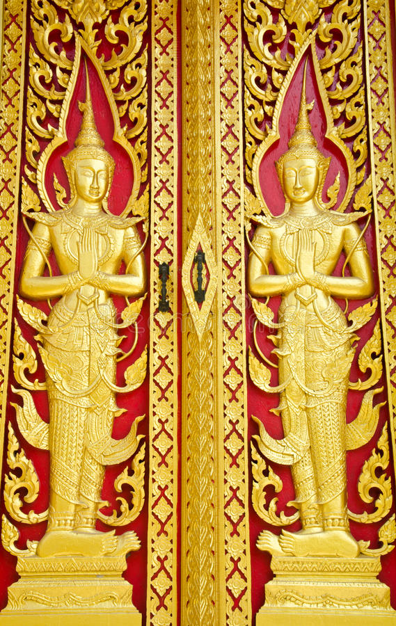 Traditional Thai style woodcraft. Images carved wood. Buddhist Churches of the door stock photos